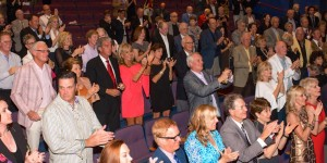 Audience having fun at charity auction