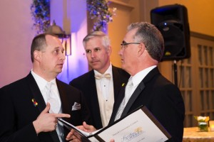 Scott Robertson consults with clients at 2015 Signatures of Greece event