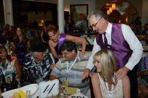 Scott Robertson coaxing bidders at SWFL Wine & Food fest 2015